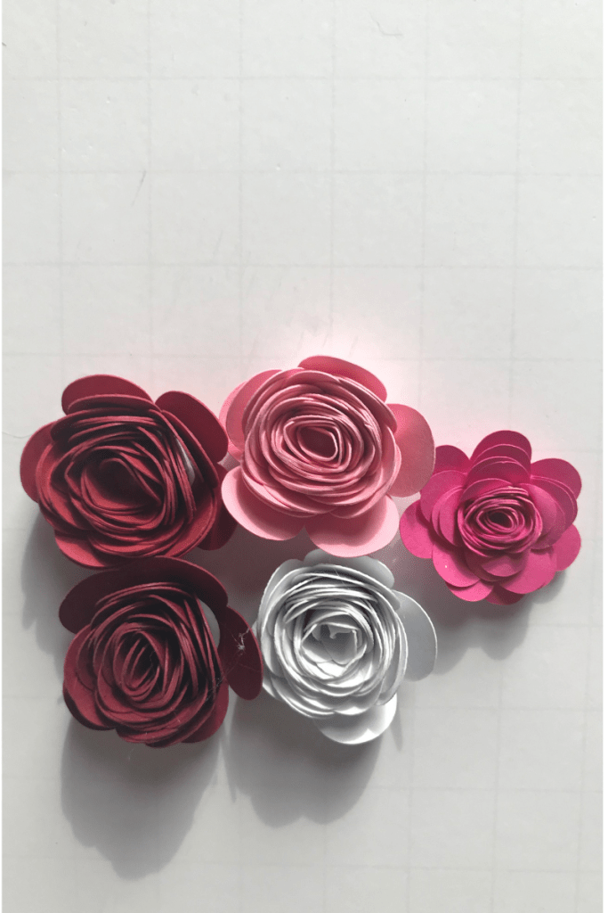 Rolled paper flowers in pink, red and white.