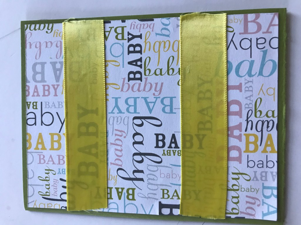Two strips of yellow wide ribbon was added to the card.
