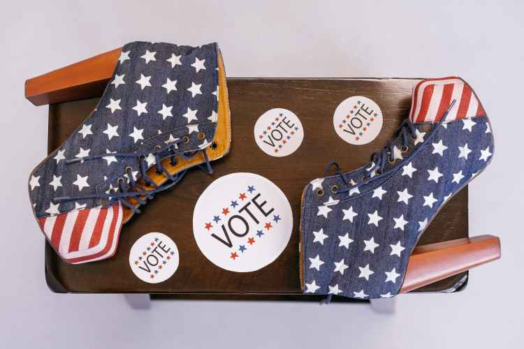 american flag themed high heels on wooden surface