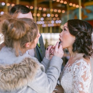helping-the-bride-makeup-touchup-suessmoments-wedding-photography