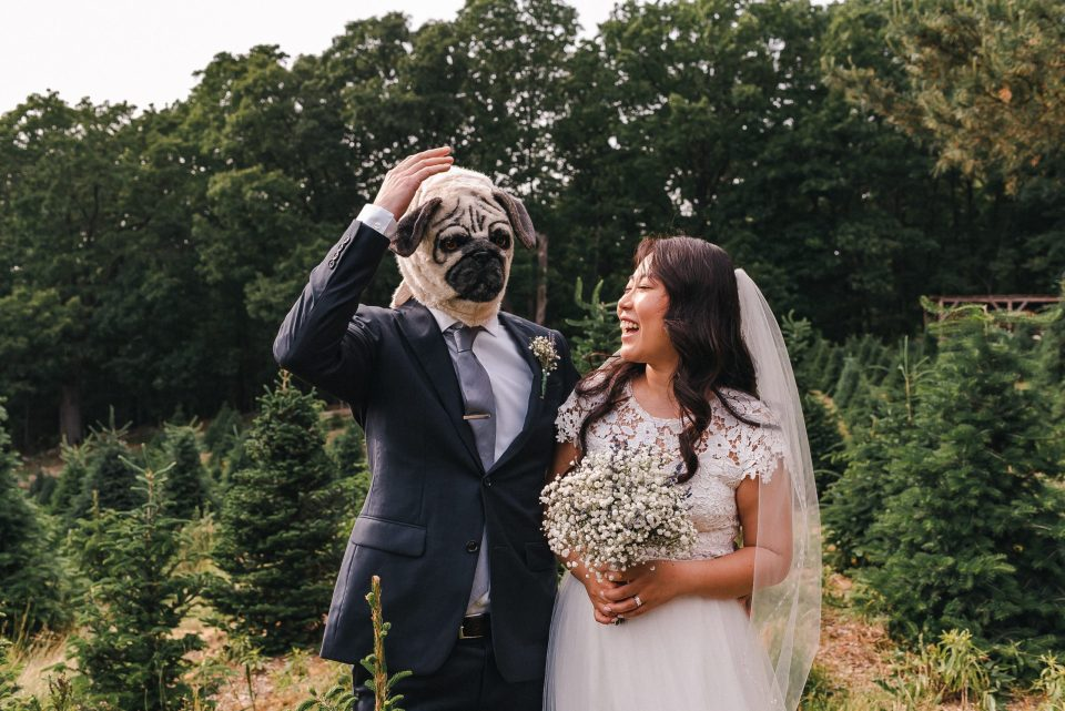 funny-bride-and-groom-wedding-photo-with-pug-dog-mask-suessmoments-new-york-photographer