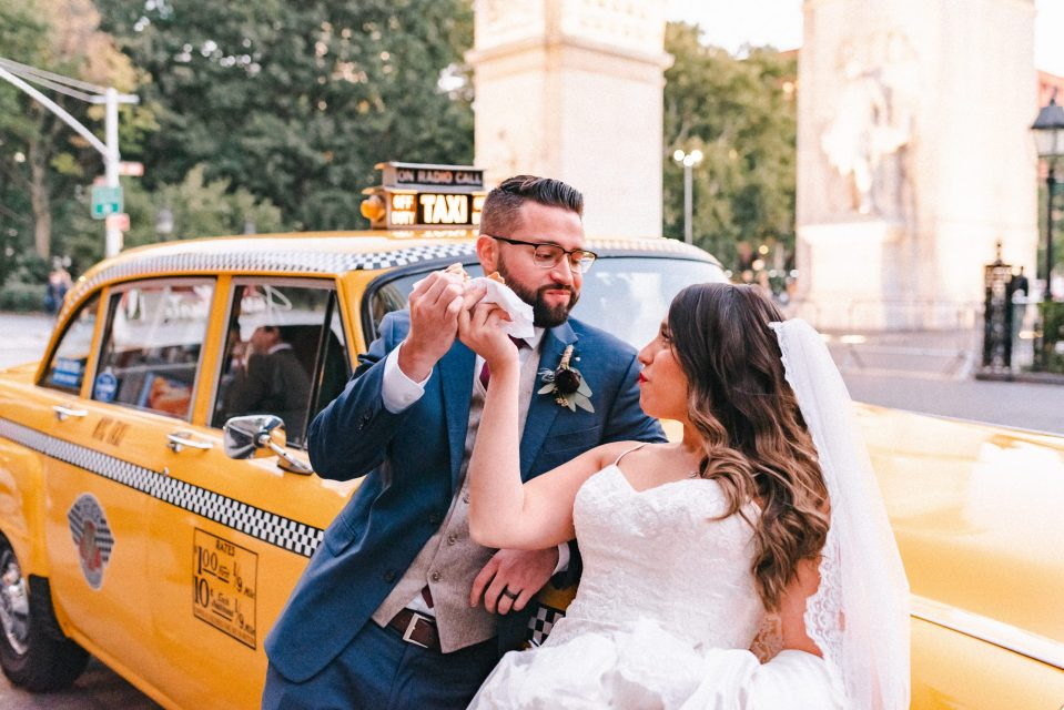yellow-classic-cab-wedding-photos-rental-suessmoments-nyc-photographer-eating-hot-dogs