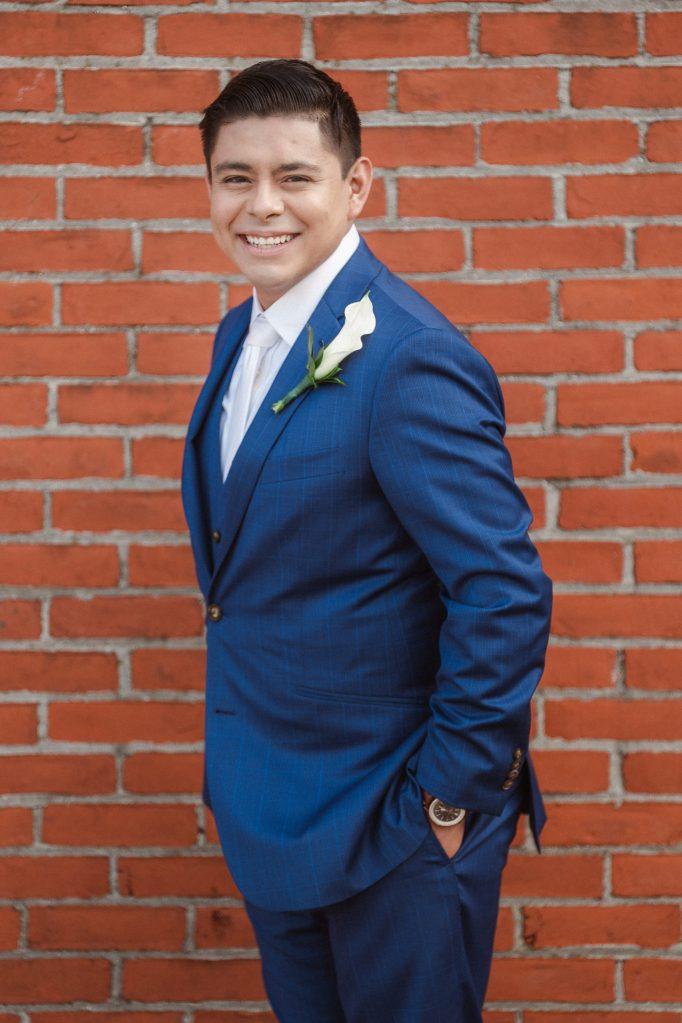 groom-portrait-by-brick-wall