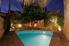 Maison de la Bourgade garden and pool, from their website