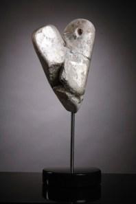 Shadow - rose alabaster, silver and gold leaf on granite