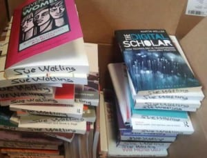 piles of books packed ready to move to EDEU