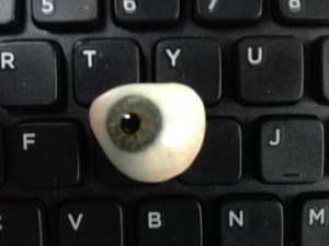 My old ocular prosthetic rests on the G and H keys of Jim's keyboard