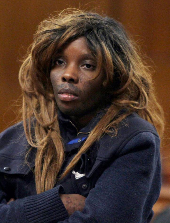 Geraldine Perkins wearing a terrible wig in court after being arrested for the murder of her son, Zymere.