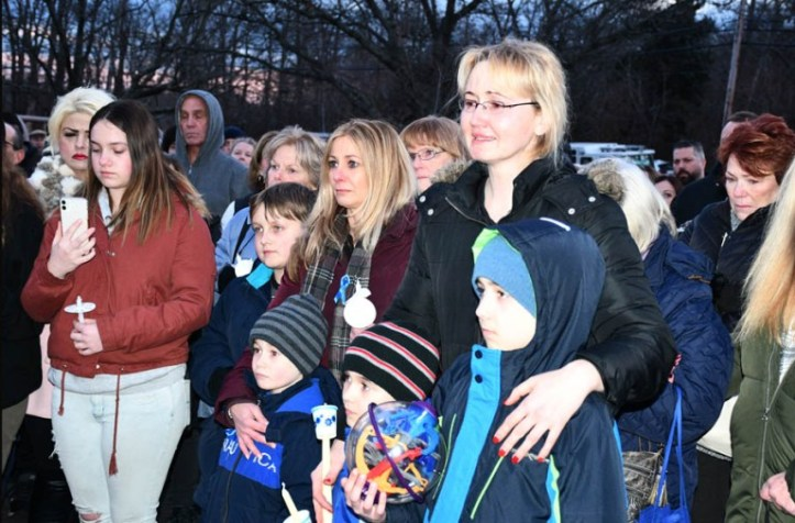 Justyna Zubka-Valva with sons Andrew and Anthony at vigil for Thomas