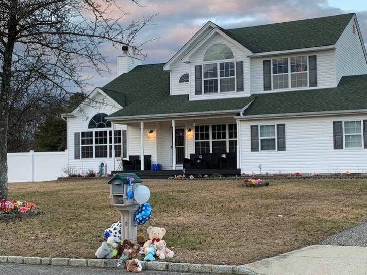 Makeshift memorial in front of Thomas Valva's house