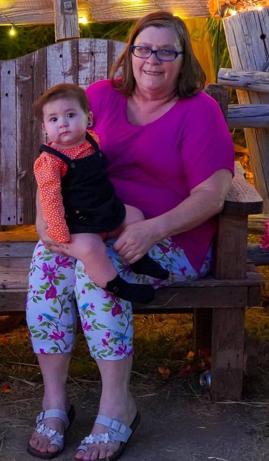 """Baby Marion Jester-Montoya being held by Grandma Sheilah """"Katie"""" Montoya"""