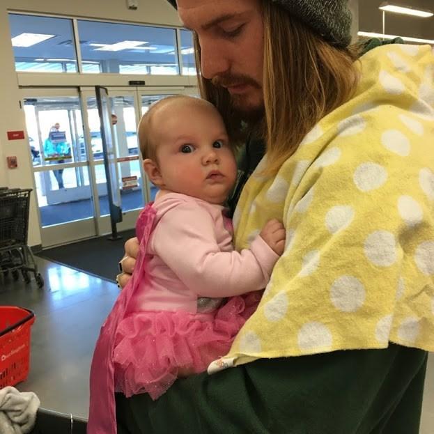 Zachary Littell holding daughter Ava