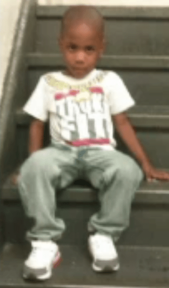 Zymere Perkins sitting on the stairs