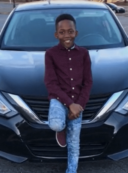 Jordan Mekhi Roberts in front of a car
