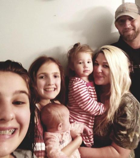 Ashley and Matt Cowan and their four daughters