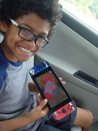 Nakota Kelly with Nintendo Switch