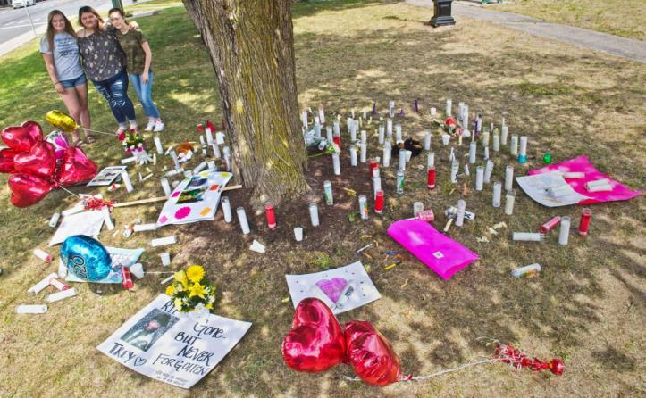 Taylor Hance, Alexis Stevens, and Emily Burgess at the site of Treyanna Summerville's vigil