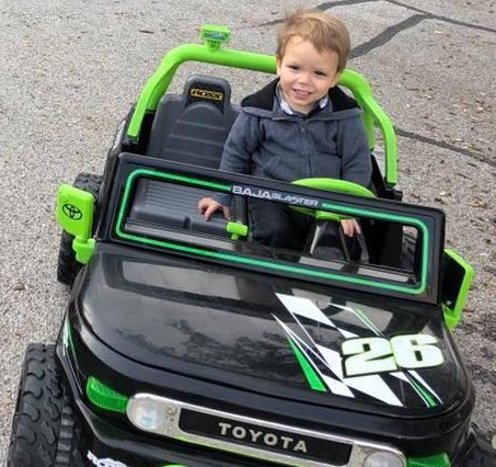 Stetson Blackburn in toy car