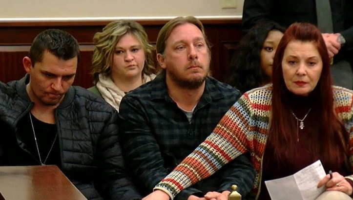 Jamie Hobbs with Jonathan and Tammy Risen at Britney Roll Mayes' sentencing hearing