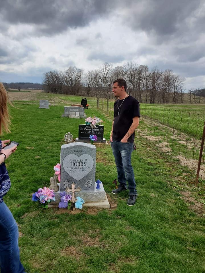 Jamie Hobbs visiting Averylee Hobbs grave