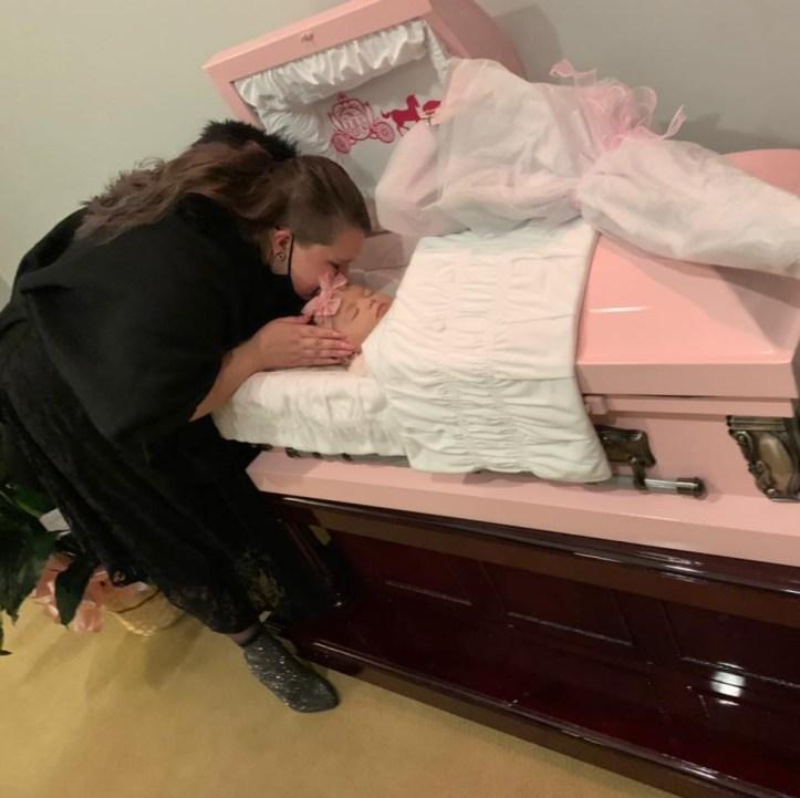 Kristin Fridley Gantt kissing Fallon Fridley's head in casket
