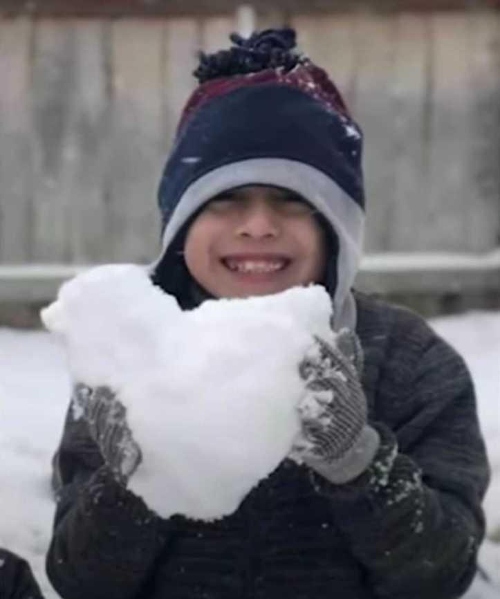 Emrik Osuna holding a snow heart