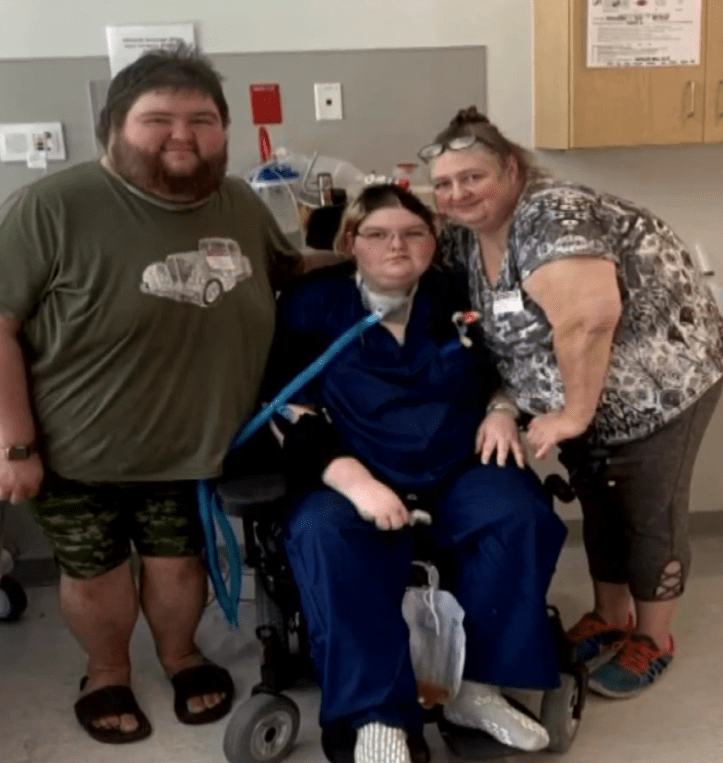 Corena Chambers (center) in the hospital, flanked by her brother, Johnny Musick, and mother, Lou. (WAVY)