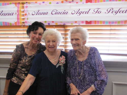 TIM GANNON PHOTO | Anna Ciacia, center, with daughter Maryann D'Augusta, left, and longtime friend Irene Kubiak, right, at Saturday's early birthday party for Ms. Ciacia, who will turn 100 on Oct. 6.