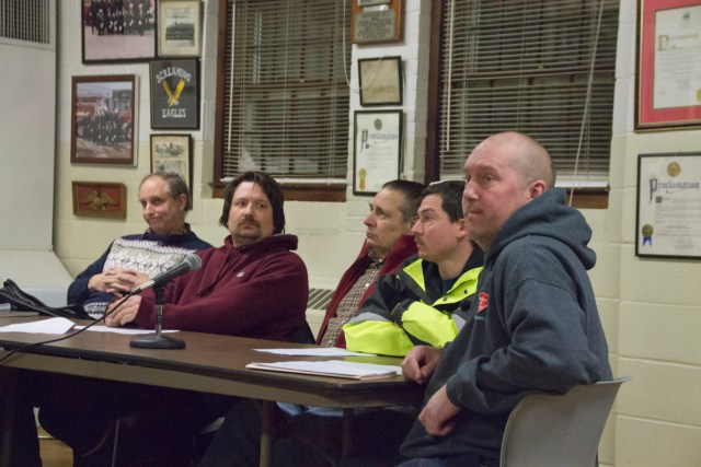 Greenport Fire Chief Harry Breese (right) addresses the Village Board at Wednesday night's meeting. (Credit: Paul Squire)