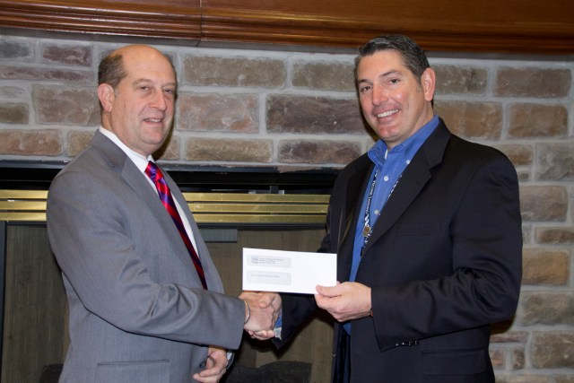 Peconic Landing CEO Robert Syron (right) hands over a check for $4,000 to Southold Superintendent David Gamberg last Friday. (Credit: Paul Squire)