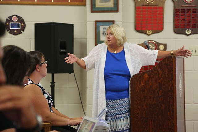 Jean Cooper addresses the crowd while claiming that 30 homeowners were committing mortgage fraud at Thursday's Greenport Village Board meeting. (Credit: Paul Squire)