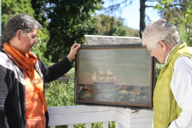 Amy Folk (left) and Freddie Wachsberger with the Bark Washington painting