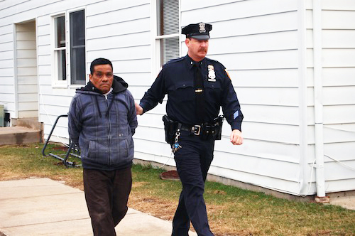 Arturo Fuentes-Chang is escorted into Southold Town Justice Court Thursday morning. (Credit: Cyndi Murray)