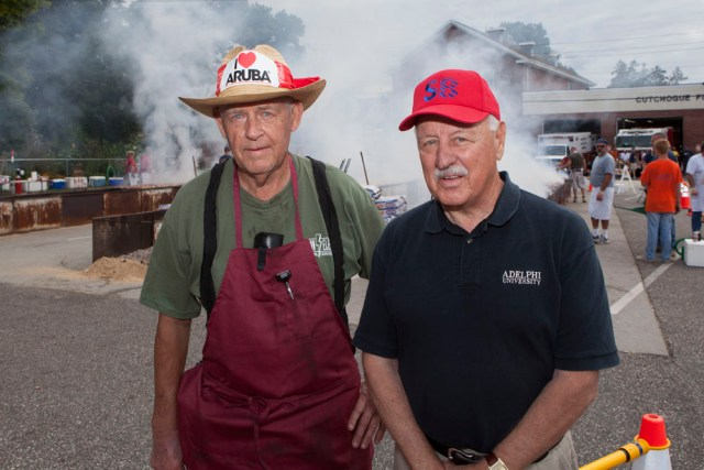 Fifty-two-year veteran of the barbecue John Lademann, left, with State Senator Ken LaValle. (Credit: Katharine Schroeder)