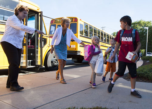 KATHARINE SCHROEDER PHOTO | Students and staff at the morning buses at Cutchogue East Elementary School  on the first day of the 2013-14 school year Monday morning.