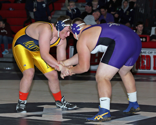 Stephen Ostrowski of Mattituck was defeated by Port Jeffersons Kyle Fiske in the 285 lbs weight class. The Suffolk County Division II wrestling championships were held at  Center Moriches High School on Feb. 15, 2014. (Photo credit: Daniel De Mato)