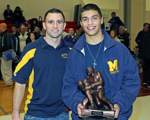 Mattituck Wrestling Coach Cory Dolson with Bobby Becker who was named Champion of Champions in the Suffolk County Division II wrestling championships were held at  Center Moriches High School on Feb. 15, 2014. (Photo credit: Daniel De Mato)