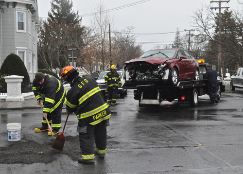 PAUL SQUIRE PHOTO | Greenport firefighters clear the scene of Tuesday afternoon's car crash.