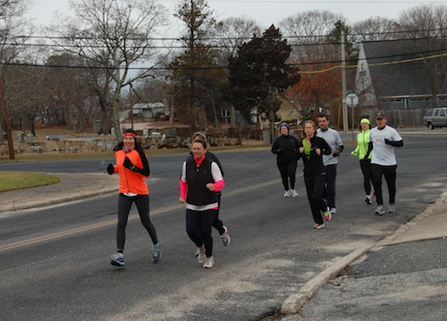 CYNDI MURRAY |Members of the NoFo Runners Club jogged in honor of the Jamesport runner who was killed Thursday.