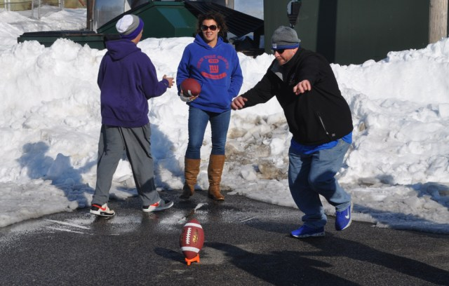 Chris Doucett tries a 50-yard field goal for fun after already winning the contest. His son Sean, left, also converted a pair of field goals and showed off his arm at times too. He's a quarterback at Greenport.