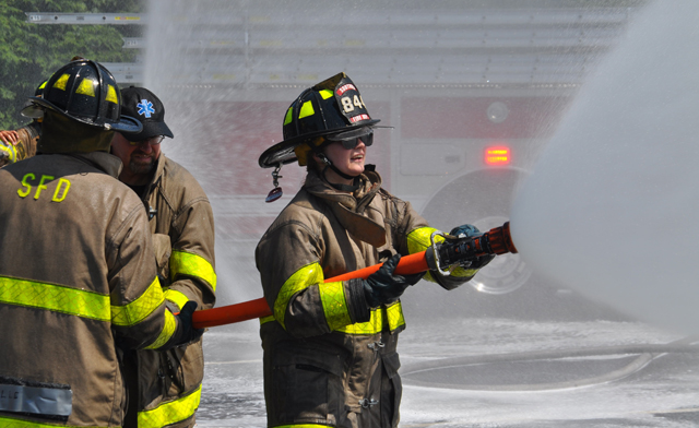 Southold, Cutchogue and East Marion fire department volunteers hosed down Southold's two new trucks and each other Sunday afternoon. (Credit: Grant Parpan)
