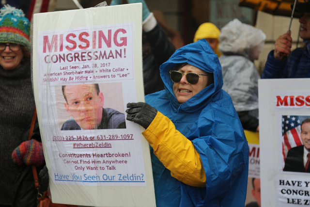Demonstrators accused the congressman of being 'missing' Tuesday. (Credit: Grant Parpan)