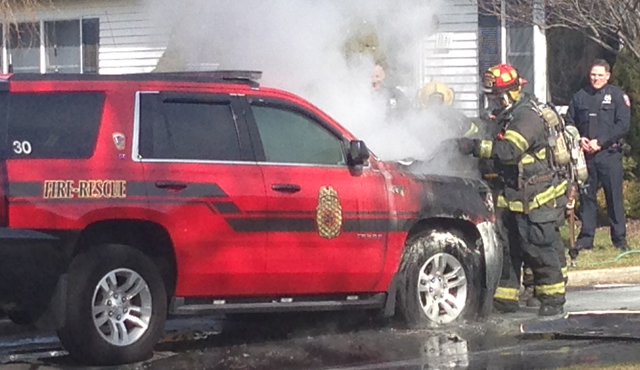 Cutchogue firefighters responded to the scene Saturday where their chiefs' vehicle caught fire. (Credit: Joe Werkmeister)