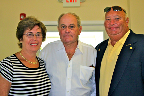 JENNIFER GUSTAVSON FILE PHOTO | Sea Tow International CEO Capt. Joseph Frohnhoefer, right, with his wife Georgia and Roy Morrow (center).
