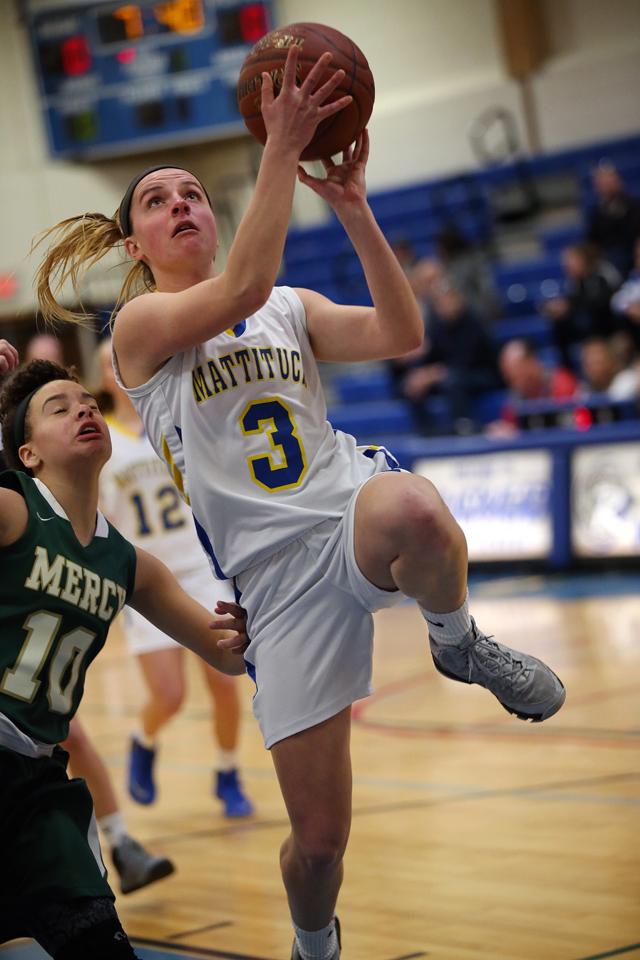 Mattituck junior Chelsea Marlborough drives to the basket. (Credit: Garret Meade)