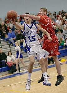 GARRET MEADE PHOTO  |  Mattituck senior Mike Mangiamele drives to the basket in the Tuckers' loss to Center Moriches Wednesday night.