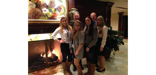 COURTESY PHOTO | Girl Scouts L to R front row: Victoria Hilton, Amanda Aurichio and Paige Confort  (all students at Greenport High School) with Troop Leader Ruthanne Corazzini.  L to R back row: LITPS Chair Robert Goldfarb, CPA and LITPS Head of Operations: Ross Kass, CPA