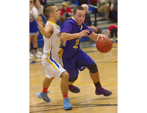 GARRET MEADE FILE PHOTO | Mattituck's Joe Tardif, left, keeps in close contact while guarding Greenport's Gavin Dibble.