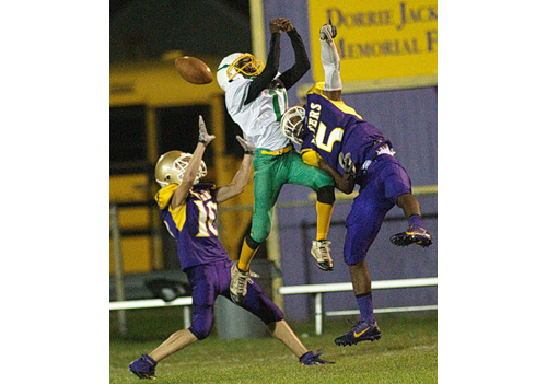 GARRET MEADE FILE PHOTO | Porters football players Connor Malone, left, and Gene Allen sandwiched Wyandanch's Kamar Harris, who was unable to catch this pass in Thursday's game.
