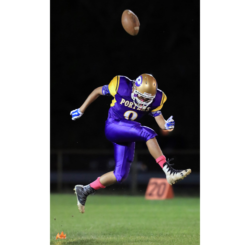 Greenport place kicker Tashan Lawrence #8 executes a perfect on side kick to start the first quarter against Wyandanch at Greenport High School in Greenport on September 7th, 2016